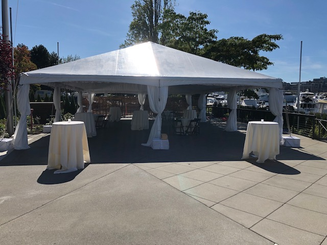 Dockside Tented Area on Patio with Background Boats